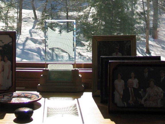 Spectra sundial amongst family portraits on a snowy day