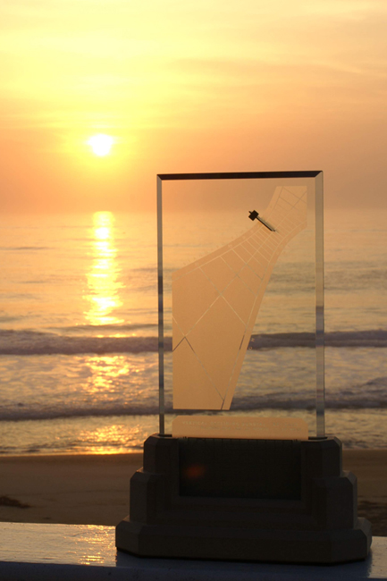 Spectra sundial greets the ocean sunrise on Cape Hatteras, North Carolina USA