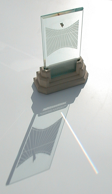 Spectra sundial with its shadow and rainbow prism beam